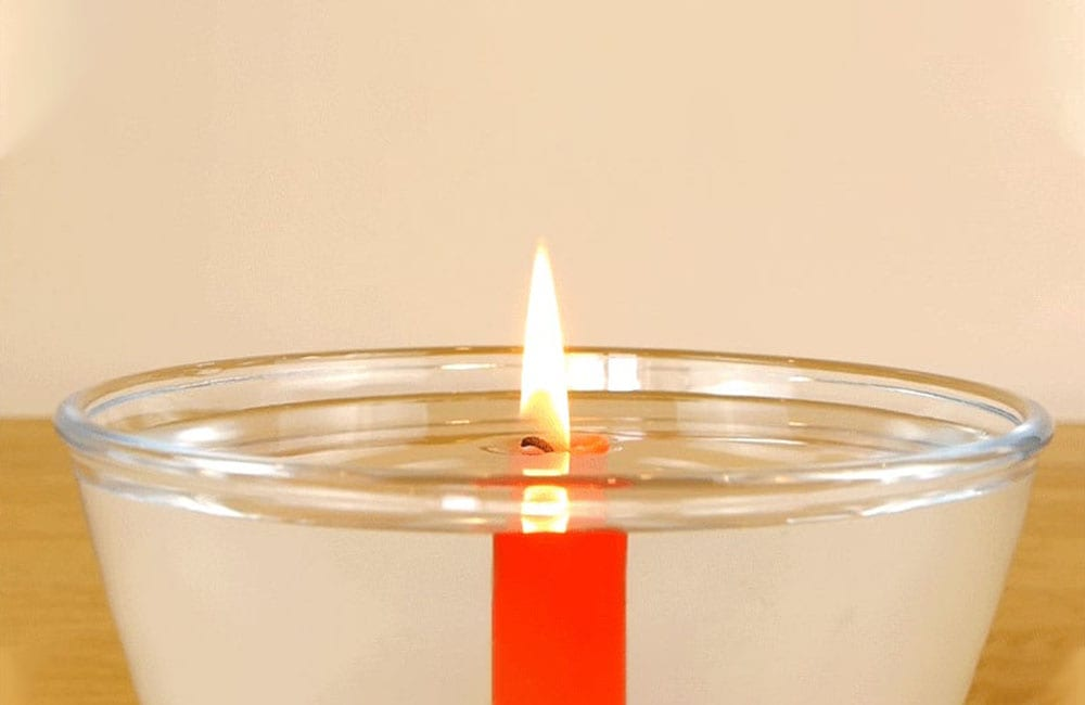A Lit Candle in a Can Will Burn in Water @jdclarkejr / Pinterest.com